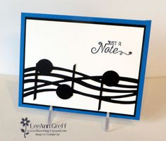 """Our team swap theme was Black and White with a pop of color and this is what I made. I got the idea from Lana Horton on Pinterest. My kids were all involved in music in school so we spent many an evening at concerts and events. I miss those days so much! Isn't the Swirly Scribbles die perfect for this card!? I made the music notes with my 3/4"""" circle punch. But I did alter the circle to be..."""