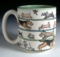 Terrier chase stoneware mug by Nan Hamilton (no critters were harmed in the making of this mug)