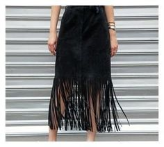 Let's get fierce with fringe! Often considered part of a more boho, casual look, this trend is experiencing a chic upgrade thanks to designers like Tamara Mellon , Michael Kors , Miu Miu , Gucci  & Stella McCartney  getting turnt on tassel. From bags to skirts to shoes, it's all about movement. So make a move to shake up your style with this DIY fringe skirt!