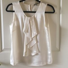 Jigsaw 100% silk ruffle front cream work blouse Cream ivory tank top by Jigsaw London! 100% silk. Very Kate Middleton and perfect for the office as a work top. Has a small prick in left shoulder from the security tag. UK size 8 which and fits like a US small Anthropologie Tops Blouses