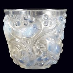 R. Lalique Molded Opalescent Glass Avallon Vase   Second quarter of the 20th century   Of tapering circular form, decorated with birds perched on meandering grape vines, in high relief. Height 5 3/4 inches.