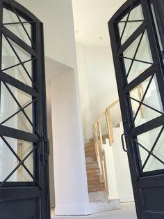 Mediterranean house with black iron contemporary door. San Antonio 78209. Custom design and build.