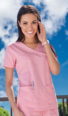Original Junior Fit mock wrap top features patch pockets, an extra angled exterior pocket, and a side utility loop. Also features back darts and side vents for shaping. Cute Scrubs, Scrubs Uniform, Nursing Shoes, Darts, Cold Shoulder Dress, Exterior, Pockets, Fit, Tops
