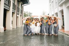 Bridesmaids dancin' in the rain!  So cute.   It's a Shore Thing Wedding Planning | Dear Wesleyann Photography | Events by Nouveau Flowers