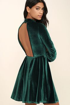 You'll be wrapped in luxury in the Embrace the Present Forest Green Velvet Skater Dress! Soft and stretchy velvet shapes a mock neck with double covered button closure and sexy open back. Fitted bodice gives way to a flirty skater skirt. Long sleeves have buttoned cuffs.