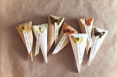 Butterflies adorn these pretty favours. #bonvoyage #vintagewedding #weddingfavours