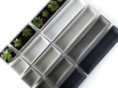 This concrete planter set is perfect for a succulent display at home or in the office. Each planter is hand made and uniquely cast. Succulents