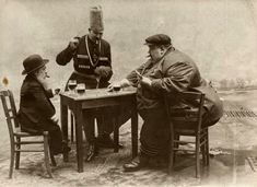 A French postcard with the tallest, shortest and fattest men of Europe playing cards in 1913