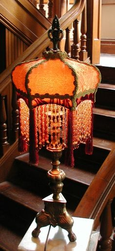 *Victorian lampshade...gold w/ muted red shadows.