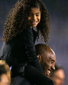 NBA Los Angeles Laker Kobe Bryant stands on the sideline with his daughter Gianna Maria-Onore Bryant on his shoulder during the 2014 US and China International friendly match at Qualcomm Stadium in San Diego California Lakers Kobe Bryant, Kobe Bryant 24, Kobe Bryant Tattoos, Lebron James, Kobe Bryant Daughters, Kobe Bryant Quotes, Kobe Quotes, Kobe Bryant Pictures, Black Mamba