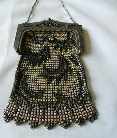 The dancing flapper girls would hold these chic bags as they danced the night away. These vintage mesh enameled purses of the era were used to hold the basic essentials like mad money and lipstick. This gorgeous purse is soft and feminine. Enamel mesh metal purses were produced widely in the 1920's