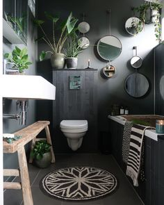 Grey decor, with round mirrors and plenty of plants in the bathroom. Monochrome rug and bath mat, white bathroom suite and beautiful rustic furniture and styling Beautiful Bathroom Designs, Online Furniture Shopping, Home Improvement Loans, Furniture Shop, Budget Home Decorating, Bathroom Plants, Bathroom Decor, Beautiful Bathrooms, Bathroom Inspiration