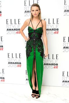 Taylor Swift in a Julien Macdonald gown, Giuseppe Zanotti shoes, Lorraine Schwartzjewels, and Ofira bands at the 2015 Elle Style Awards at Sky Garden at The Walkie Talkie Tower on Feb. 24, 2015, in London.   - Cosmopolitan.com