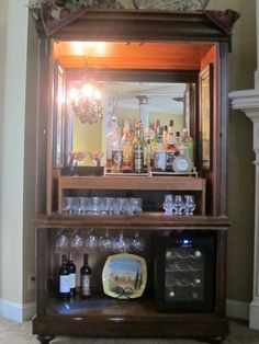 I have been wanting to do this for years!!!  Turn an old TV armoire into a bar.