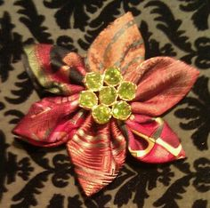 Flower pin made from scraps of men's silk ties.