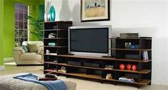 """Our 51"""" Samsung 1080p 3D HDTV is wall mounted, but Ikeep asking Shawn to build something like this idea. He has SO many components, & I would love to put all his electronics, speakers, woofers, beaters, & noise makers on one unit, with some pictures & candles. Make it more """"family"""" like."""