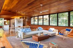 All the wood panels yess! Childhood throwback to endless, house-length teak panels|Neutral Modern Great Room With Wood Paneling|Organically Inspired | Fresh Faces of Design | HGTV