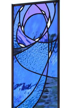 Stained glass window panel in blue night sky