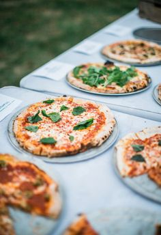 Yes to brick oven pizzas at the reception // Erin L. Taylor Photography