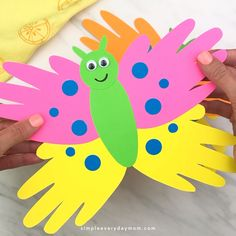 This handprint butterfly craft is great for toddlers, preschool kids and for kindergarten. It's an easy DIY art project for kids to make for Mother's Day or when learning about bugs and insects! - Handprint Butterfly Craft For Kids Handprint Butterfly, Butterfly Crafts, Butterfly Art, Flower Crafts, Diy Flowers, Paper Flowers, Spring Crafts For Kids, Crafts For Kids To Make, Kids Diy