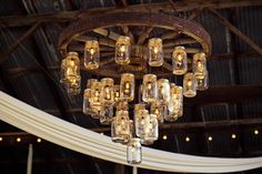Mason jars chandelier. Really adds to a rustic decor!  Can use wire for candle…
