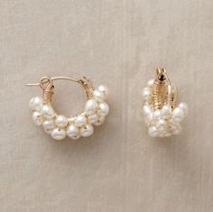 "Froth Of Pearls Hoops Little cultured pearls envelop 14kt goldfill hoops in a luminous froth. The gems are wired by hand; the earrings finished with snap down wires. Made in USA. 5/8""L."