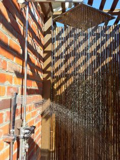 Water droplets against black bamboo shower