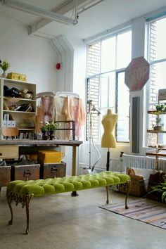 This looks like a fabulous boho chic studio! I would turn it into a beautiful sewing room. I'd keep the green bench though!