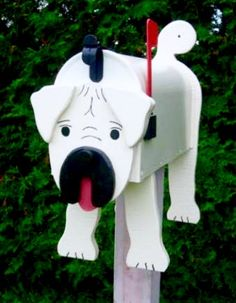 Pug mailbox - Great gift idea! Handcrafted and hand painted animal mailboxes by artist Michel Devost in Quebec. If you would like to order a special mailbox, contact Michel at http://pages.globetrotter.net/miche/mailboxes.html