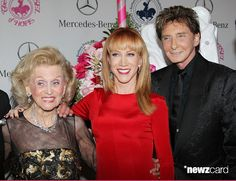 (L-R) Carousel of Hope Chairman Barbara Davis, Kathy Griffin and Barry Manilow attend the 2014 Carousel of Hope Ball held at The Beverly Hilton Hotel on October 11, 2014 in Beverly Hills, California.  (Photo by Michael Tran/FilmMagic)