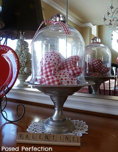 How about tucking some heart pillows under a cloche for a festive Valentine's Day touch?