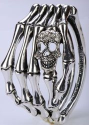 Bracelet, skeletal fingers with a rhinestone skull and hinged closure.  So darn sassy!