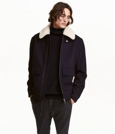 Dark blue. CONSCIOUS. Bomber jacket in felted fabric made from recycled wool and polyester with a detachable faux fur collar. Tab and snap fastener at top,