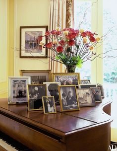 A collection of family photographs spanning the generations rests on the Steinway & Sons piano in the living room. The painting, by Senator Kennedy, depicts boats, one of his favorite subjects. Piano Living Rooms, Piano Room, Formal Living Rooms, My Living Room, Living Room Furniture, Dining Rooms, Baby Grand Pianos, Living Room Arrangements, Hamptons House