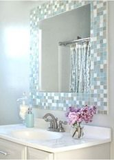 Gorgeous! Going to have to give this mosaic tile bathroom mirror a try. My builder's grade mirror edges are starting to look awful.