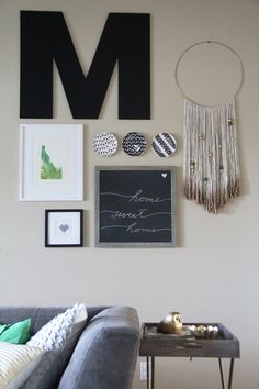 Gallery wall with many elements: chalkboard, plates, watercolor, cross stitch, yarn wall hanging