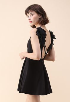You'll running on wings and some flare in this fun cami dress boasting pretty angel wings that cascade from the shoulders and down the plunging back. Its subtle enough to create a low-key look yet brings just enough drama set your style apart from the crowd