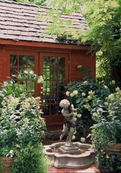 Red garden house with French doors. Would make a nice office, reading nook, craft room, or guest room.
