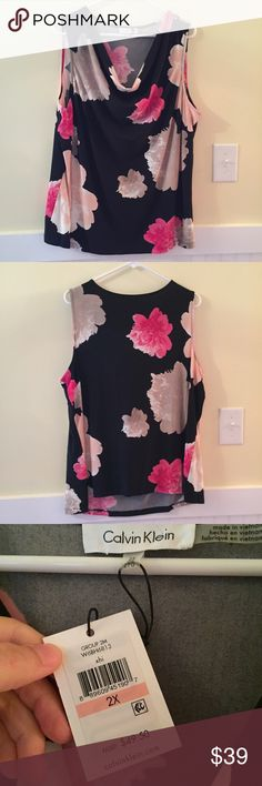 NWT CALVIN KLEIN FLORAL BLOUSE New with tags, in flawless condition, and from a smoke free environment. This piece is so perfect for the office. Any questions, please ask! Always happy to consider reasonable offers, just hit make an offer! Low balls offers will be ignored. Calvin Klein Tops