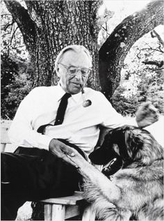 Carl Orff playing with his dog.