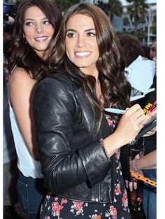 Tip: Feminine floral dresses look great with edgy, rockerish leather jackets—it creates the perfect soft-hard balance.  Twilight star Nikki Reed signed autographs at Comic-Con in a cool, collar-less version.   - Cosmopolitan.com