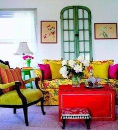 the perfect way to mix pattern and color! Yellow, red, green, and floral traditional room with a Moroccan vibe.