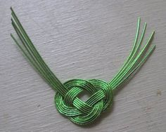 Japanese abolone knot gift embellishment. Step by step instructions.