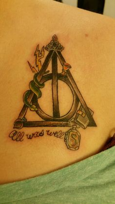 The deathly hallows symbol with all 7 horcruxes incorporated into it. With the words all was well underneath