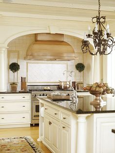 Beautiful Kitchen love the Arch above the stove range & hood.