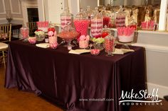 My candy table at my wedding this year will look like this, but has several different levels of the apothecary jars!