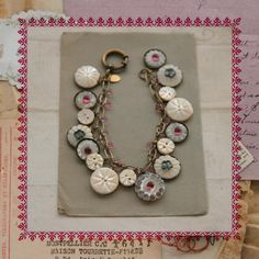 Remember this idea for my antique glass buttons for jewelry