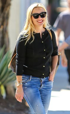 Reese Witherspoon made jeans and a simple cardigan look totally chic with statement black cat-eye sunnies and a red lip!