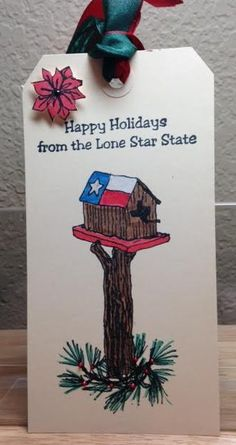 "Texana Designs sample by Texana Designs owner Jimmye Sue Mitchell using our Texana Designs Jam'n Birdhouse, Jam'n Pine Needles, Jam'n Poinsettia mini and ""Happy Holiday from the Lone Star State"" stamps."