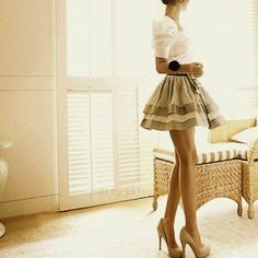 A full skirt with nude heels